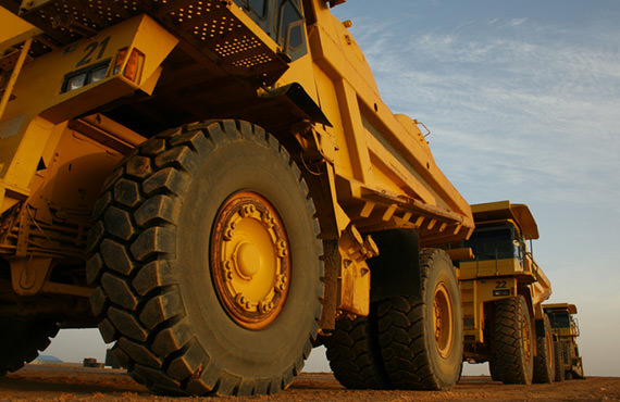 Ore in open pit mines is frequently transported by mine haul trucks.